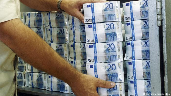 Man carrying banknotes in denominations of 50, 20 and 10 euros
