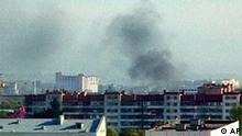 Smoke rises during clashes between security forces and gunmen, Nalchik, southern Russia, video still