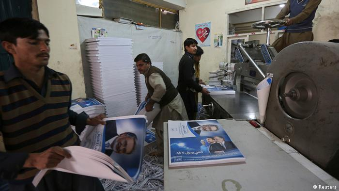 Laborers print election posters in Kabul.
