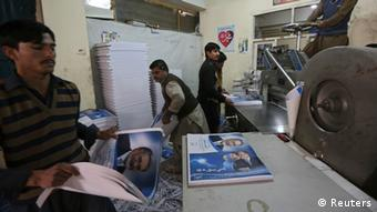 Workers print posters of presidential election candidates at a printing press in Kabul, January 29, 2014 (Photo: REUTERS/Omar Sobhani)