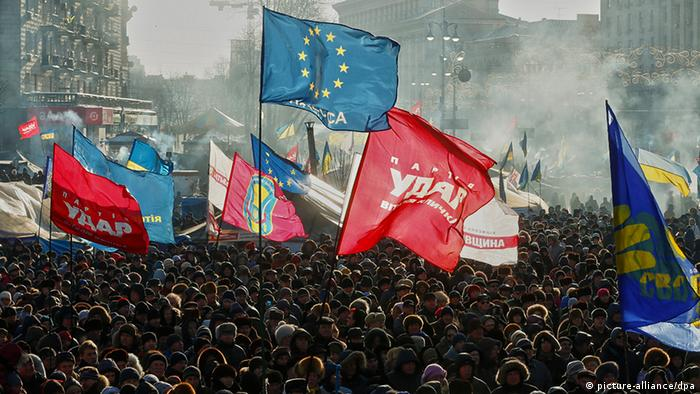 A major protest in Kyiv, on Februay 2, 2014, with flags - including EU flags - prominently visible. (Photo via dpa)