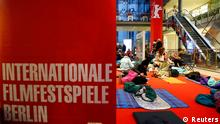 People queue to buy tickets for the upcoming 64th Berlinale International Film Festival in Berlin February 3, 2014. The festival runs from February 6 until 16 in the German capital. REUTERS/Tobias Schwarz (GERMANY - Tags: ENTERTAINMENT SOCIETY)
