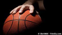 Symbolbild Basketball. #41218283 Fragment of a basketball ball in a hand of the basketball player. Copyright: BortN66 - Fotolia.com