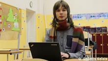 Aleksejs Popovs uses his laptop computer in a classroom; Riga, January 2014; Copyright: Gederts Gelzis