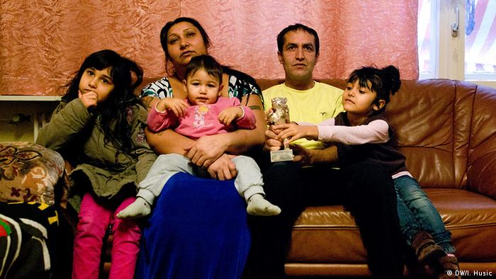 Portrait of Mujic family together on the sofa in their asylum house in Berlin Photo: Ieva Husic