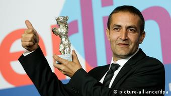 Portrait of Nazif Mujic holding Silver Bear award at Berlinale Film Festival Photo: AP Photo/Markus Schreibe