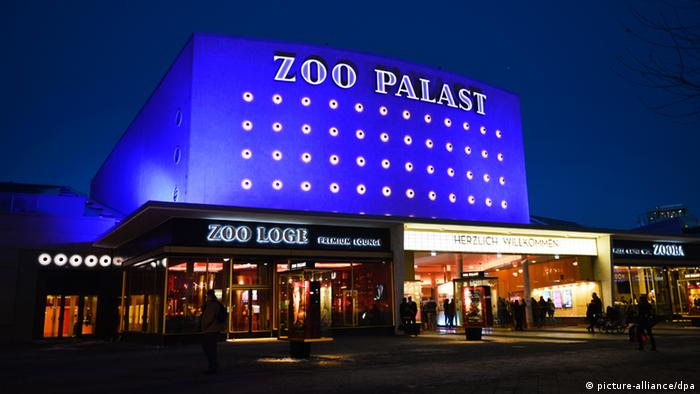 Berlinale Zoo Palast illuminated in blue from the outside