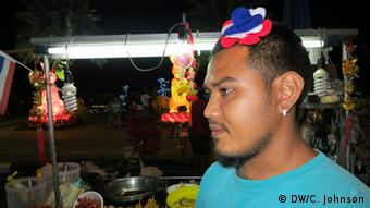 Boy, a street-food seller in Surat Thani, says police often harass him for wearing Thai protest colors.