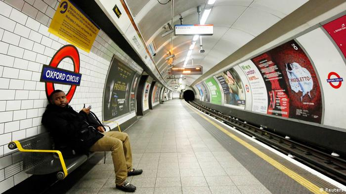 Man waiting at empty Tube station