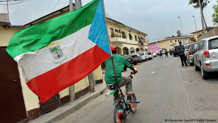 Bike rider with flag of Equatorial Guinea