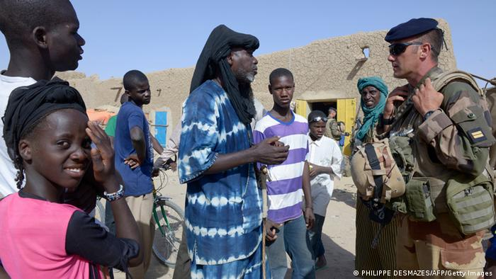 A citizen of Gao talks to a peacekeeper. Photo: PHILIPPE DESMAZES/AFP/Getty Images
