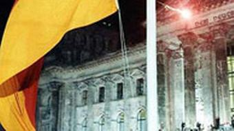 The German flag flying in front of the Reichstag building