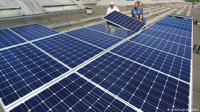 A solar cell system is installed on a business roof in Chemnitz.