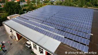 Solar panels line the roof of a small business in Rostock
