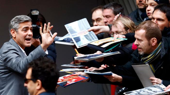 George Clooney surrounded by fans at the opening of the Berlinale, Copyright: Reuters