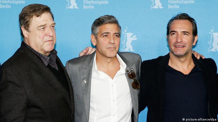 John Goodman, George Clooney and Jean Dujardin at the press conference for The Monuments Men at the Berlinale 2014, Copyright: picture-alliance/dpa