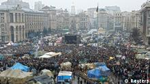 People attend an anti-government rally in Kiev February 9, 2014. Thousands of Ukrainian protesters gather for another big rally in central Kiev amid ongoing tensions and demands for President Viktor Yanukovich to resign. REUTERS/David Mdzinarishvili (UKRAINE - Tags: POLITICS CIVIL UNREST)