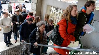 Swiss voters queuing to cast ballot (EPA/WALTER BIERI EPA/WALTER BIERI)