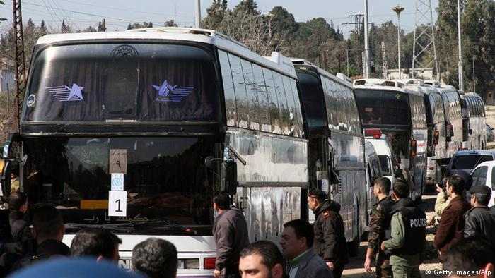 Civilians being evacuated from Homs