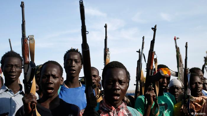 Rebels in south Sudan holding high their weapons