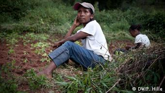 Louisette Vohangy Malala sitting in the field where she grows cassava