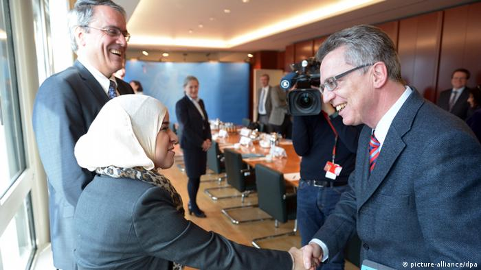 Thomas de Maiziere meeting with migrants