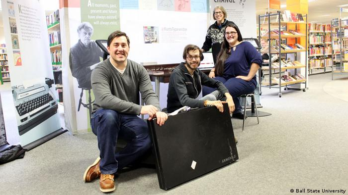 Portrait from left of, Kyle Royse, Andrew Neylon, Lacey Lord and Rai Peterson sitting at the Dresden Public Library. The group brought the exhibit from Indiana to Dresden Photo: Ball State University