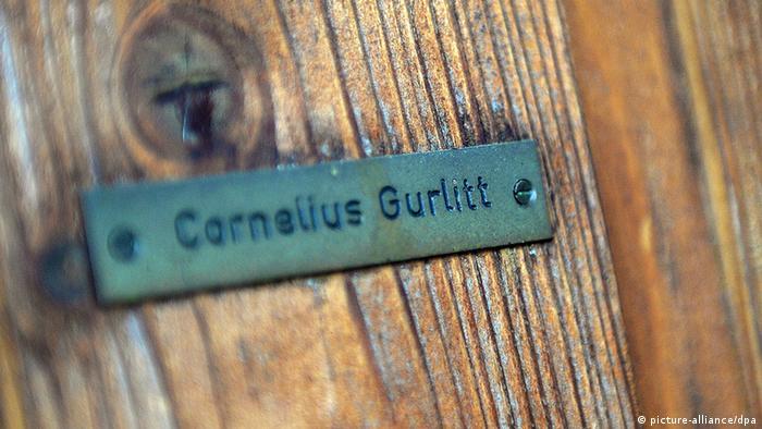 Name sign on a door reading 'Cornelius Gurlitt', Copyright: picture-alliance/dpa
