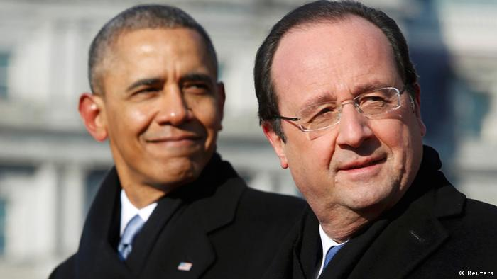 US President Barack Obama (L) and French President Francois Hollande stand next to each other on stage during a State Arrival ceremony on the South Lawn of the White House in Washington, February 11, 2014 (Photo: REUTERS/Jonathan Ernst)