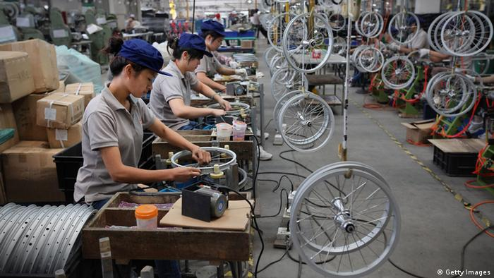 Chinese workers assembling bicycles