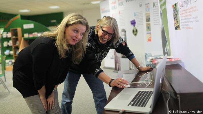 Elke Ziegler, left, and Rai Peterson prepare the Vonnegut exhibit for the public. Ziegler said the digital aspects make the information especially compelling for new users Photo: Ball State University