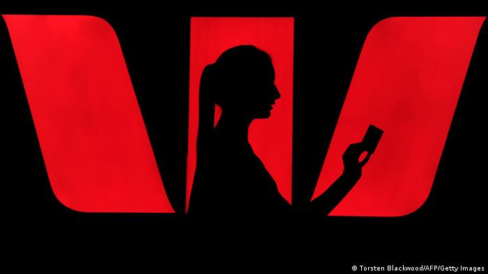 A woman's silhouette in front of a Westpac logo
