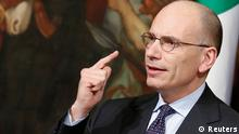 Italian Prime Minister Enrico Letta gestures during a news conference at Chigi Palace in Rome February 12, 2014. Italian Prime Minister Enrico Letta resisted growing pressure on Wednesday to resign and let centre-left leader Matteo Renzi form a new government, as discontent grows with the slow pace of economic reforms. REUTERS/Remo Casilli (ITALY - Tags: POLITICS)