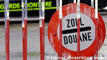 A customs sign is seen at the border post of Meyrin, near Geneva, on December 1, 2008. The European Union has given the green light for Switzerland to join the border-free Schengen zone covering 24 countries on the continent. As of December, 12 systematic checks on individuals will be abolished and cooperation will be increased in the fight against cross-border crime. While terrestrial borders will no longer have passport control points, goods traffic will still be subject to regular customs searches. AFP PHOTO / FABRICE COFFRINI (Photo credit should read FABRICE COFFRINI/AFP/Getty Images)