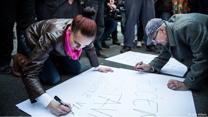 Young and old protesters gathered together to make signs in Sarajevo (photo: Jodi Hilton)