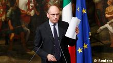 Italian Prime Minister Enrico Letta gestures during a news conference at Chigi Palace in Rome February 12, 2014. Letta resisted growing pressure on Wednesday to resign and let centre-left leader Matteo Renzi form a new government, as discontent grows with the slow pace of economic reforms. REUTERS/Remo Casilli (ITALY - Tags: POLITICS)