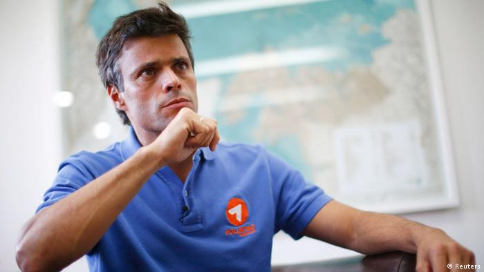 Venezuelan opposition leader Leopoldo Lopez pauses during an interview with Reuters in Caracas, February 11, 2014. Lopez says he is seeking to draw millions of Venezuelans into the streets to join protests decyring corruption, crime and shortages in a nationwide push to bring down President Nicolas Maduro's government. But the opposition leader, who is spearheading a protest campaign under the banner The Exit, denies accusations he is fomenting a coup similar to a botched attempt to oust then-President Hugo Chavez in 2002, saying he hopes to force Maduro into stepping down. Picture taken February 11, 2014. To match Interview VENEZUELA-OPPOSITION/LOPEZ REUTERS/Jorge Silva
