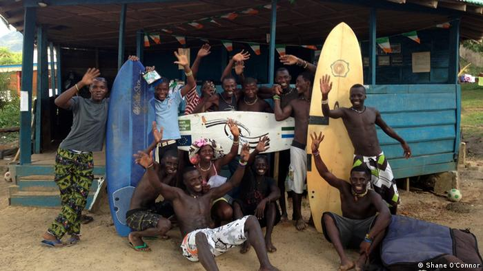 Young Sierra Leonean surfers in front of their clubhouse