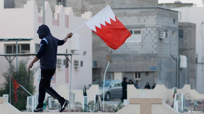 Bahrain protester with a flag