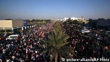 Tens of thousands of Bahraini pro-democracy protesters wave signs and national flags during a march along a divided four-lane highway near Barbar, Bahrain, west of the capital of Manama, on Saturday, Feb. 15, 2014. Protesters called for the long-serving prime minister, Sheik Khalifa bin Salman Al Khalifa, to step down and for democracy in the Gulf island kingdom. (AP Photo/Hasan Jamali)
