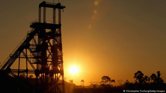 The sun rising over a derelict gold mine shaft in South Africa-