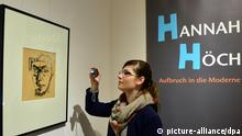 Ein Selbstportrait von Hannah Höch (1889-1978) aus dem Jahr 1942 betrachtet eine junge Frau am 13.02.2014 in Gotha (Thüringen) in der neuen Sonderausstellung Hannah Höch - Aufbruch in die Moderne. Die Schau im Herzoglichen Museum ist vom 15. Februar bis zum 4. Mai zu sehen. Foto: Martin Schutt/dpa