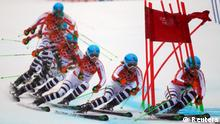 Germany's Viktoria Rebensburg clears a gate during the second run of the women's alpine skiing giant slalom event at the 2014 Sochi Winter Olympics at the Rosa Khutor Alpine Center February 18, 2014. Picture taken with multiple exposure function. REUTERS/Dominic Ebenbichler (RUSSIA - Tags: SPORT SKIING OLYMPICS)