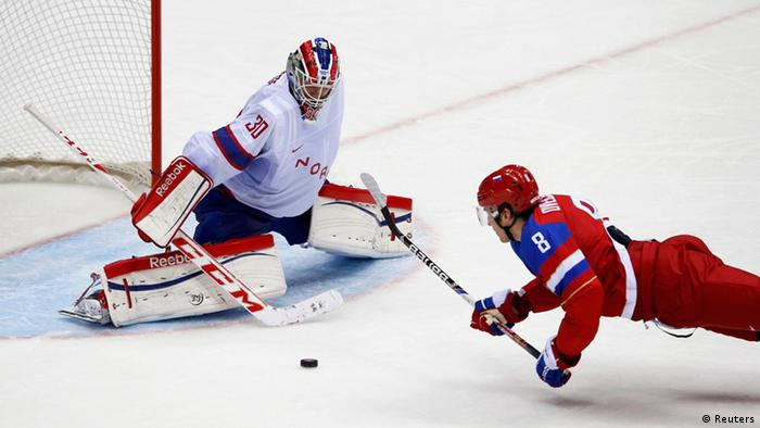 Russia's Alexander Ovechkin (R) falls while driving to the net against Norway's goalie Lars Haugen during the third period of their men's qualification round ice hockey game at the 2014 Sochi Winter. Photo: Reuters