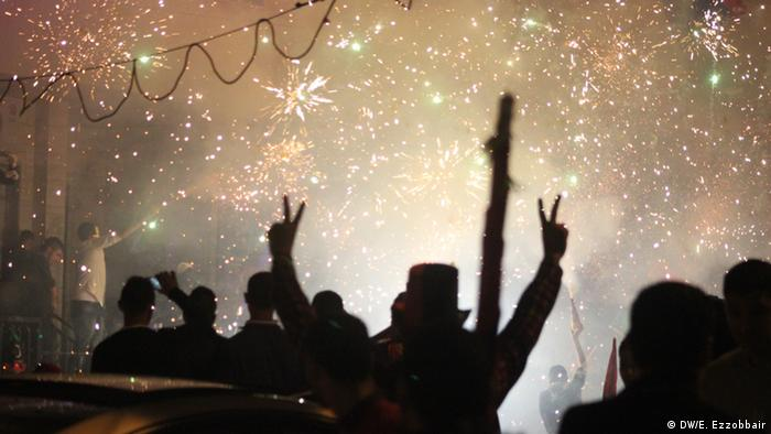 Fireworks and silhouettes of people celebrating the third anniversary of Gadhafi's downfall in Tripoli, 17.02.2014. Esam ezzobbair
