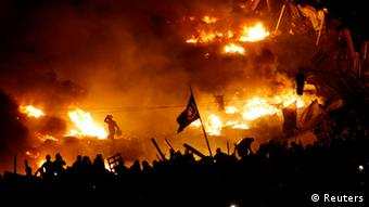 Fires burning on Maidan and protesters waving flags (Photo: Vasily Fedosenko/REUTERS)