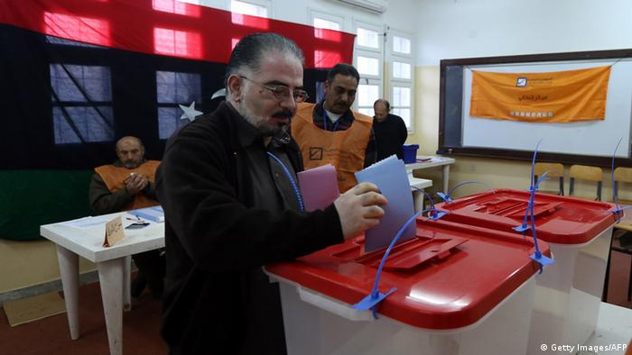 A Libyan man casts his vote to elect a constituent assembly at a polling station in the capital Tripoli on February 20, 2014. Photo: Getty