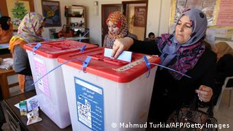 Women casting their votes in February 2014 for Libya's constituent assembly