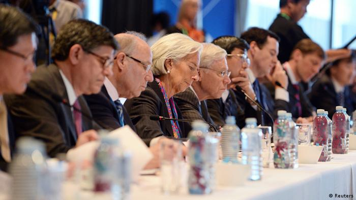 vInternational Monetary Fund Chief Christine Lagarde (C) attends the Joint G20 and B20 Infrastructure Roundtable meeting as part of the G20 Finance Ministers and Central Bank Governors meeting in Sydney. REUTERS/Dan Himbrechts/pool (