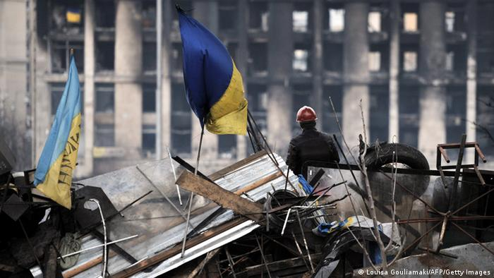 An anti-government protester stands on a barricade at the Independence square in central Kiev on February 22, 2014. Ukraine's leader and opposition on Friday signed a deal to end the splintered country's worst crisis since independence after three days of carnage left nearly 100 protesters dead. President Viktor Yanukovych's dramatic decision to hold early elections and form a new unity government was met with caution by the tens of thousands gathered on central Kiev's main square for a protest that began exactly three months earlier. (Photo: LOUISA GOULIAMAKI/AFP/Getty Images)